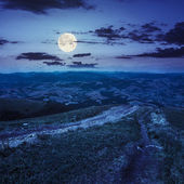 Path to village in mountain valley at night  — Stock Photo