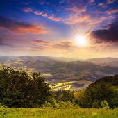 Village in mountain valley at sunset — Stock Photo