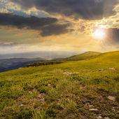 Stones on the hillside of mountain range at sunset — Stock Photo