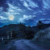 Fence on hillside in mountain at night — Stock Photo