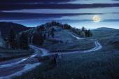 Cross road on hillside meadow in mountain at night — Foto Stock