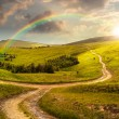 Cross road on hillside meadow in mountain at sunrise at sunset — Stock Photo #61335481