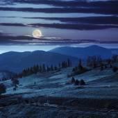 Path near field with haystacks at night — Stock Photo