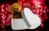 Bear with orchid in heart box — Stock Photo