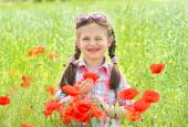 Girl on red flower poppy meadow — Stock Photo