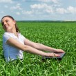 Woman with notebook in the green field — Stock Photo #52991309