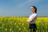 Woman in yellow flower field — Stock Photo