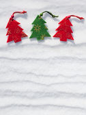 Christmas tree toys at snow background — Stock Photo
