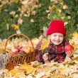 Little girl in autumn park with apple basket — Stock Photo #56224687