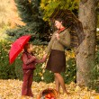 Woman and little girl in autumn park with apple basket — Stock Photo #56225269