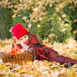 Little girl in autumn park with apple basket — Stock Photo #56397037
