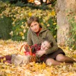 Woman and little girl in autumn park with apple basket — Stock Photo #56397059
