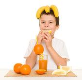 Boy drink orange juice with a straw — Stock Photo