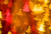 Photo of red and golden fir trees boke as background — ストック写真