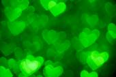 Green heart shape photo holiday background — Stock Photo