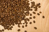 Coffee seeds on wooden background — Stock Photo