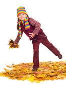 Girl on autumn leaves studio shoot — Stock Photo