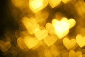 Yellow heart shape holiday background — Stock Photo