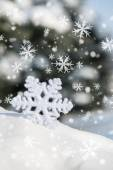 Big snowflake toy with snowfall — Zdjęcie stockowe