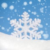 Big snowflake toy with snowfall on sky background — Stockfoto