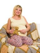 Happy pregnant woman on sofa — Stock Photo