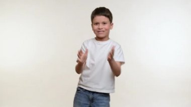 Boy grimacing and have fun. White background — Stok video