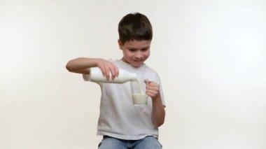 Boy drinking milk. White background — Stock Video