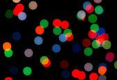 Colorful circle shape boke on dark as background — Stock Photo