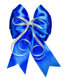 Blue bow with silver ribbon made from silk — Stock Photo