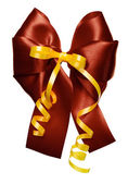 Brown bow with golden ribbon made from silk — Stock Photo