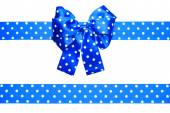 Blue bow and ribbon with white polka dots made from silk — Stock Photo