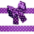 Violet bow and ribbon with white polka dots made from silk — Stock Photo #70436681