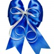 Blue bow with silver ribbon made from silk — Stock Photo #71117545