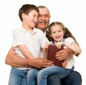 Grandfather and grandchildren portrait — Stock Photo