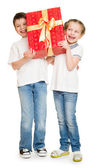 Two child with gift boxes — Stock Photo