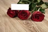 Red rose flower on wood — Stockfoto