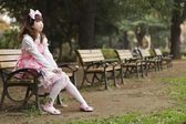 Japanese lolita cosplay in park — Stock Photo