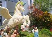 Unicorn created by flowers with fairy — Stockfoto