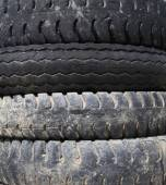 Old car tires by texture background  — Stockfoto