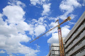 Yellow crane at construction site — Stock Photo