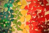 Many Colorful propellers decorated on the wall — Stock Photo