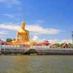 Golden Big Buddha statue near Chao praya River — Stock Photo #78060506