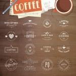 set van vintage style-elementen voor etiketten en badges voor koffie, met houtstructuur, kopje koffie en een Kladblok op de achtergrond — Stockvector  #51951651