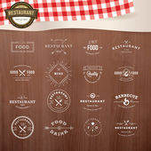 Set of vintage style elements for labels and badges for restaurants, with wood texture and elements of restaurant inventory in the background — Stok Vektör