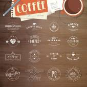 Set of vintage style elements for labels and badges for coffee, with wood texture, cup of coffee and a notepad in the background — Stock Vector