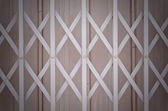 Pink metal grille sliding door with aluminium handle — Stock Photo