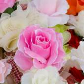 Artificial rose flowers bouquet made from satin cloth — Stock Photo