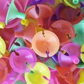 Colorful plastic cups for latex balloon — Stock Photo