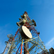 Telecommunication towers with antennas against blue sky — Stock Photo #61827413
