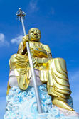 Big golden Bodhisattva statue with blue sky at Hatyai ,South of — Stock Photo